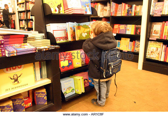 lewis-aged-two-looks-at-books-in-a-book-shop-waterstones-nottingham-ar1c8f